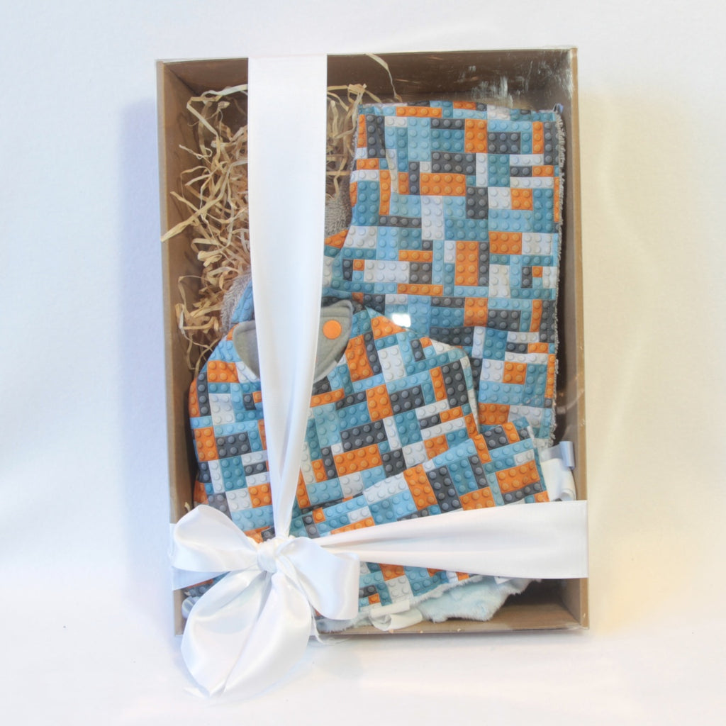 Mucky Duck Crafts blue grey orange building blocks gift pack containing regular dribble bib burp cloth and sensory cloth taggy