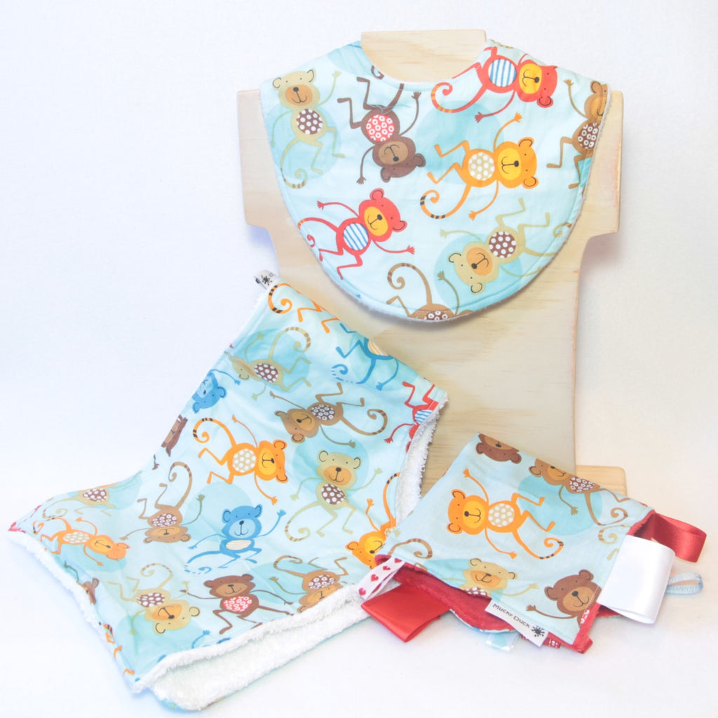 Mucky Duck Crafts pale blue with red orange and brown monkeys gift pack containing regular dribble bib burp cloth and sensory cloth taggy