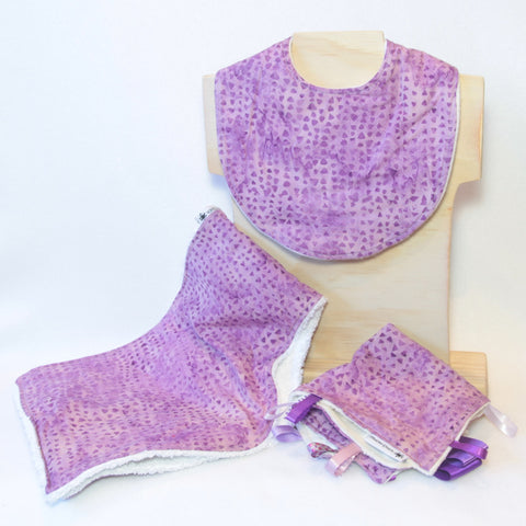Mucky Duck Crafts purple triangles geometric pattern gift pack containing regular dribble bib burp cloth and sensory cloth taggy