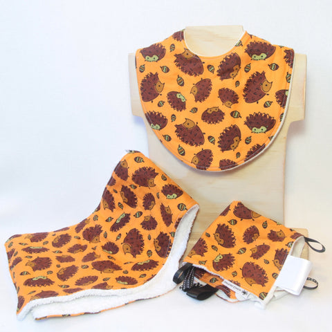 Mucky Duck Crafts orange with hedgehogs gift pack containing a regular dribble bib burp cloth and sensory cloth taggy