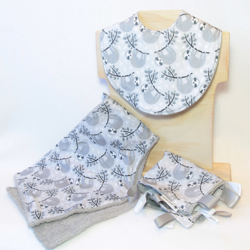 Mucky Duck Crafts greyscale sloth print gift pack containing a regular dribble bib burp cloth and sensory cloth taggy