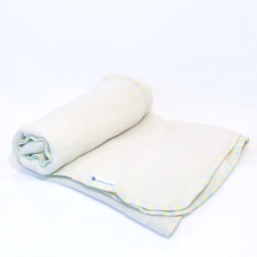 Mucky Duck pastel rainbow edged cream alpaca wool pram blanket