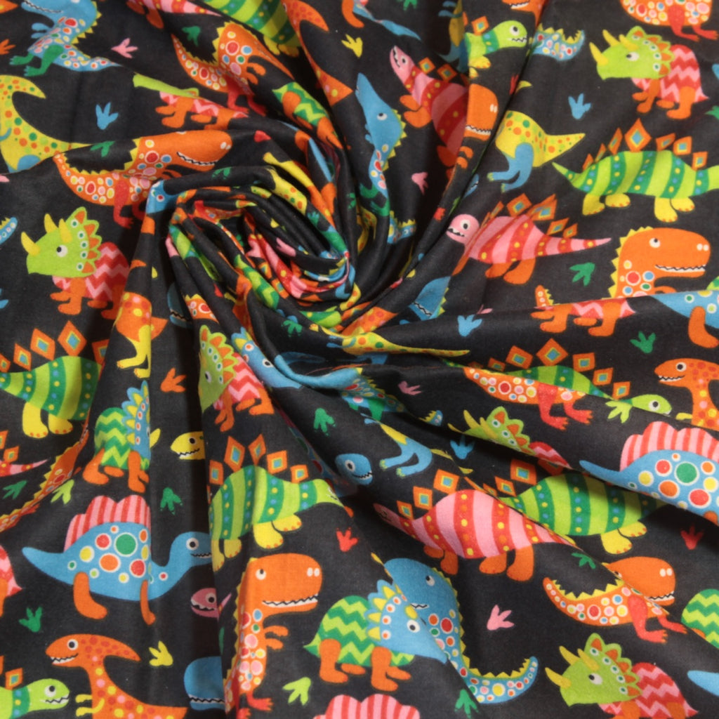 Mucky Duck Crafts Navy with bright multicoloured dinosaurs flannelette swaddle wrap