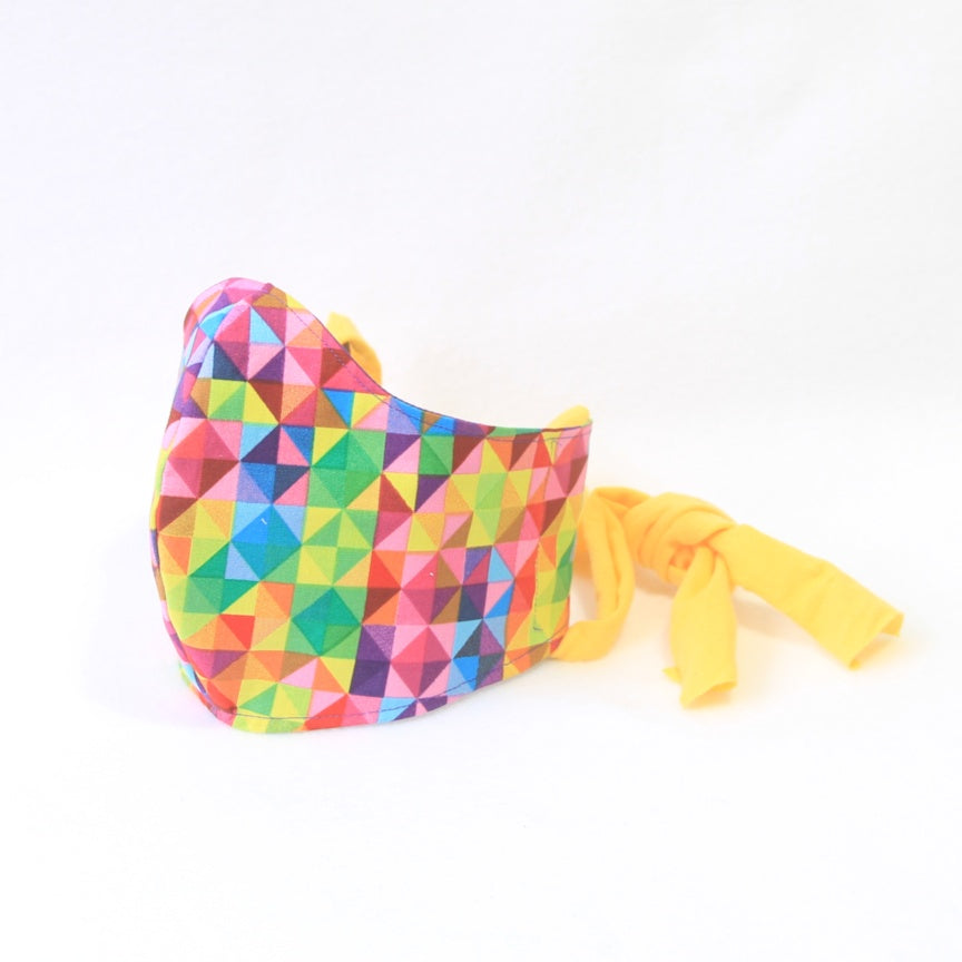 Mucky Duck Crafts medium adult fabric face mask in bright geometric pattern with a yellow tie