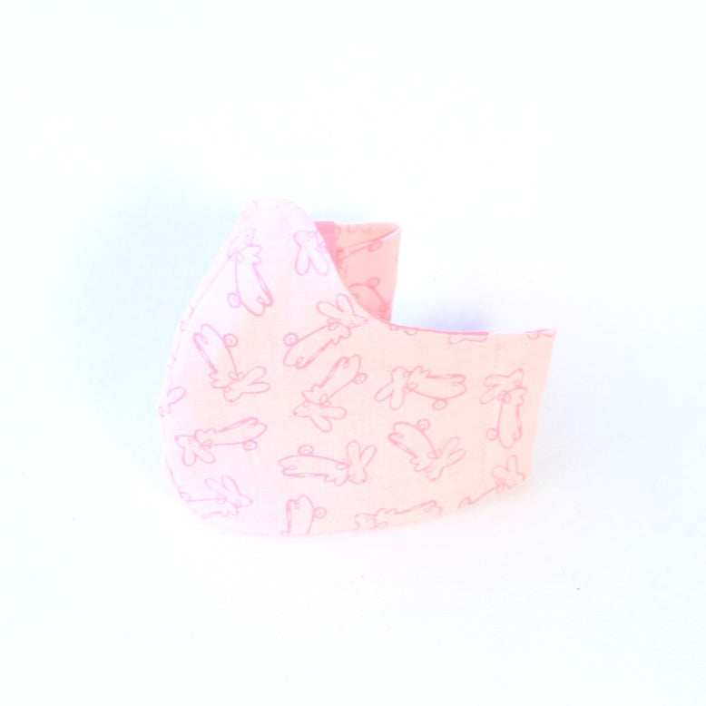 Mucky Duck Crafts kids sized cotton face mask with stretchy cotton lycra head tie in a pale pink with pink bunnies
