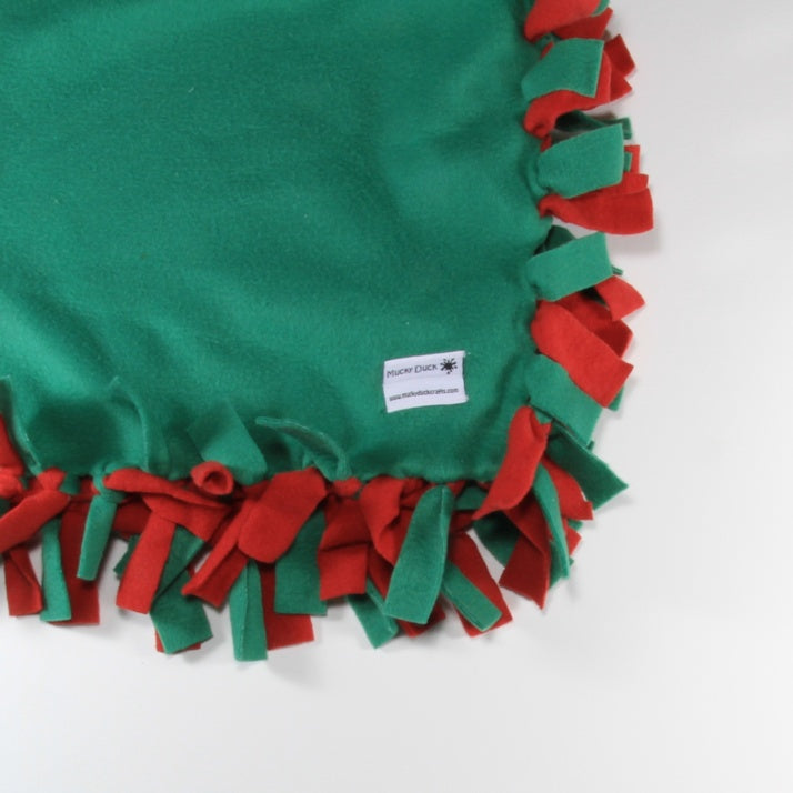Mucky Duck red and green knitted edge fleece pram blanket