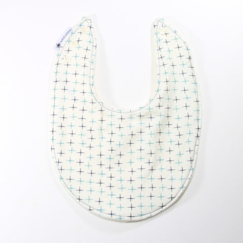 Mucky Duck cream with teal and navy crosses dribble bib