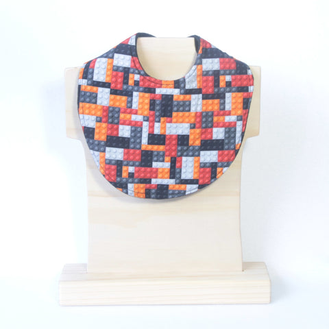 Mucky Duck Crafts red orange grey black building blocks dribble bib
