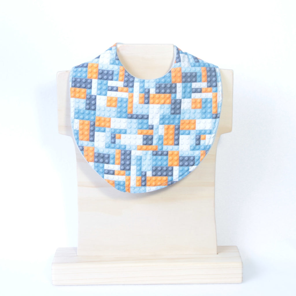Mucky Duck Crafts blue orange and grey building blocks dribble bib