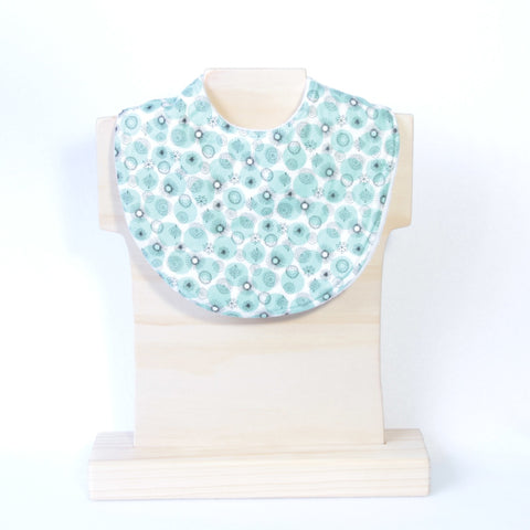 Mucky Duck white with mint and black pattern dribble bib