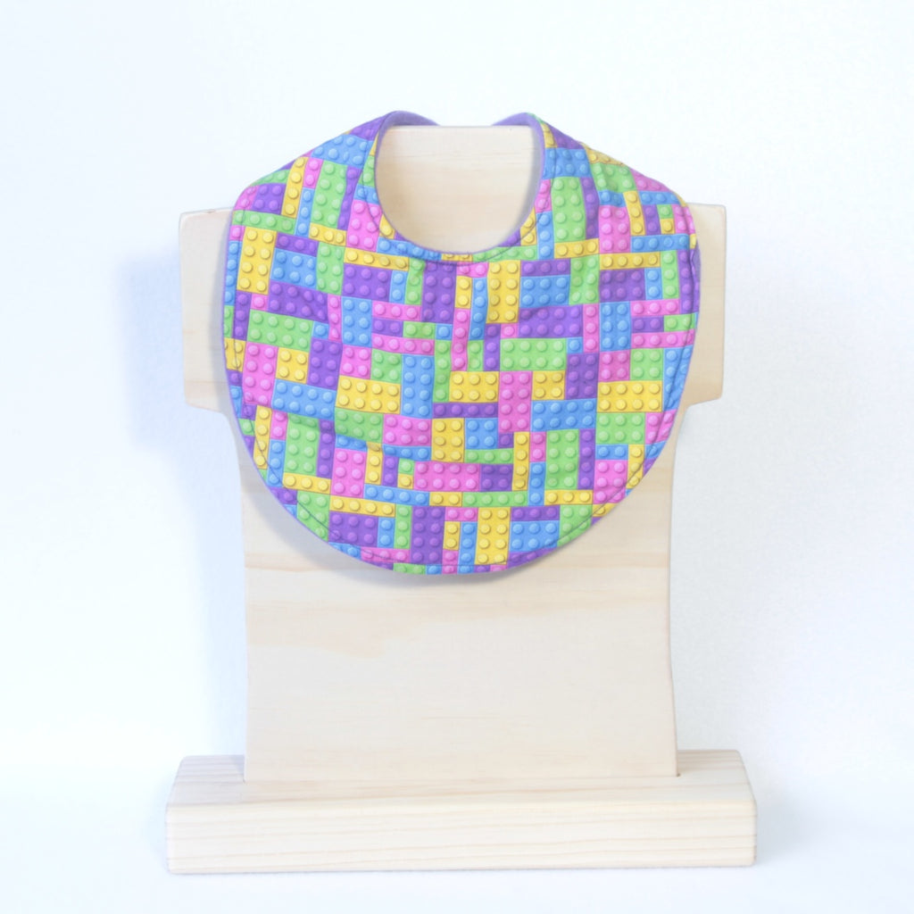 Mucky Duck Crafts purple pink yellow and blue building block regular dribble bib