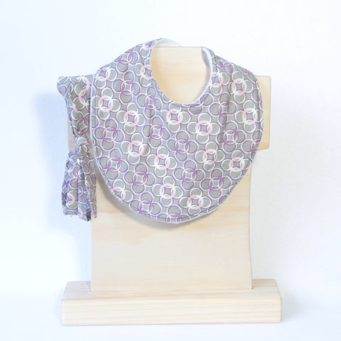 Mucky Duck Crafts Grey with purple pink and white circles geometric pattern regular dribble bib and matching top knot headband