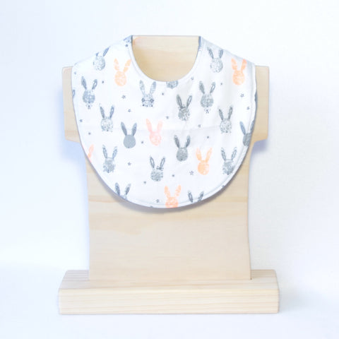 Mucky Duck Crafts white with grey and orange fluro rabbit head silhouettes regular dribble bib