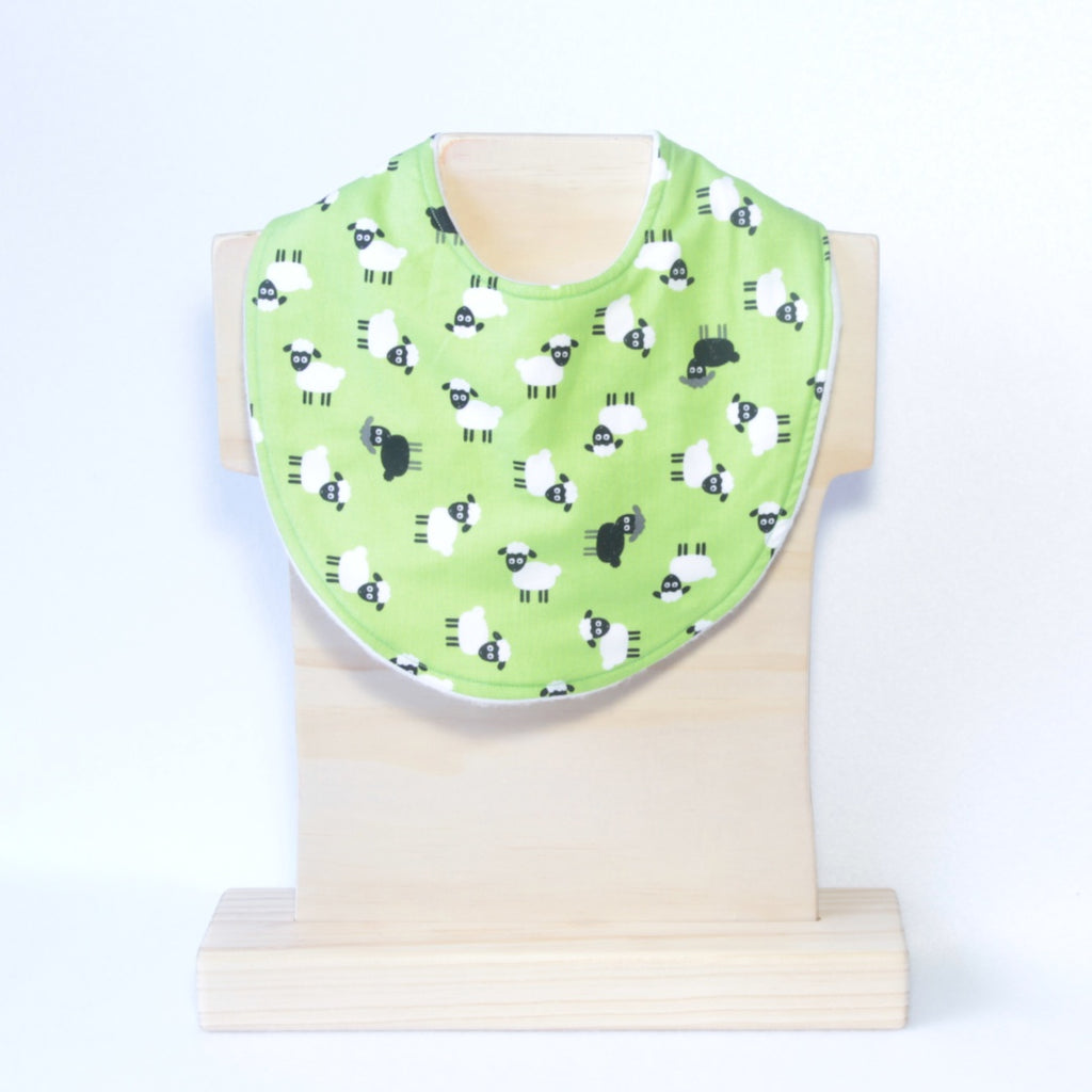 Mucky Duck Crafts bright green with black and white sheep regular dribble bib
