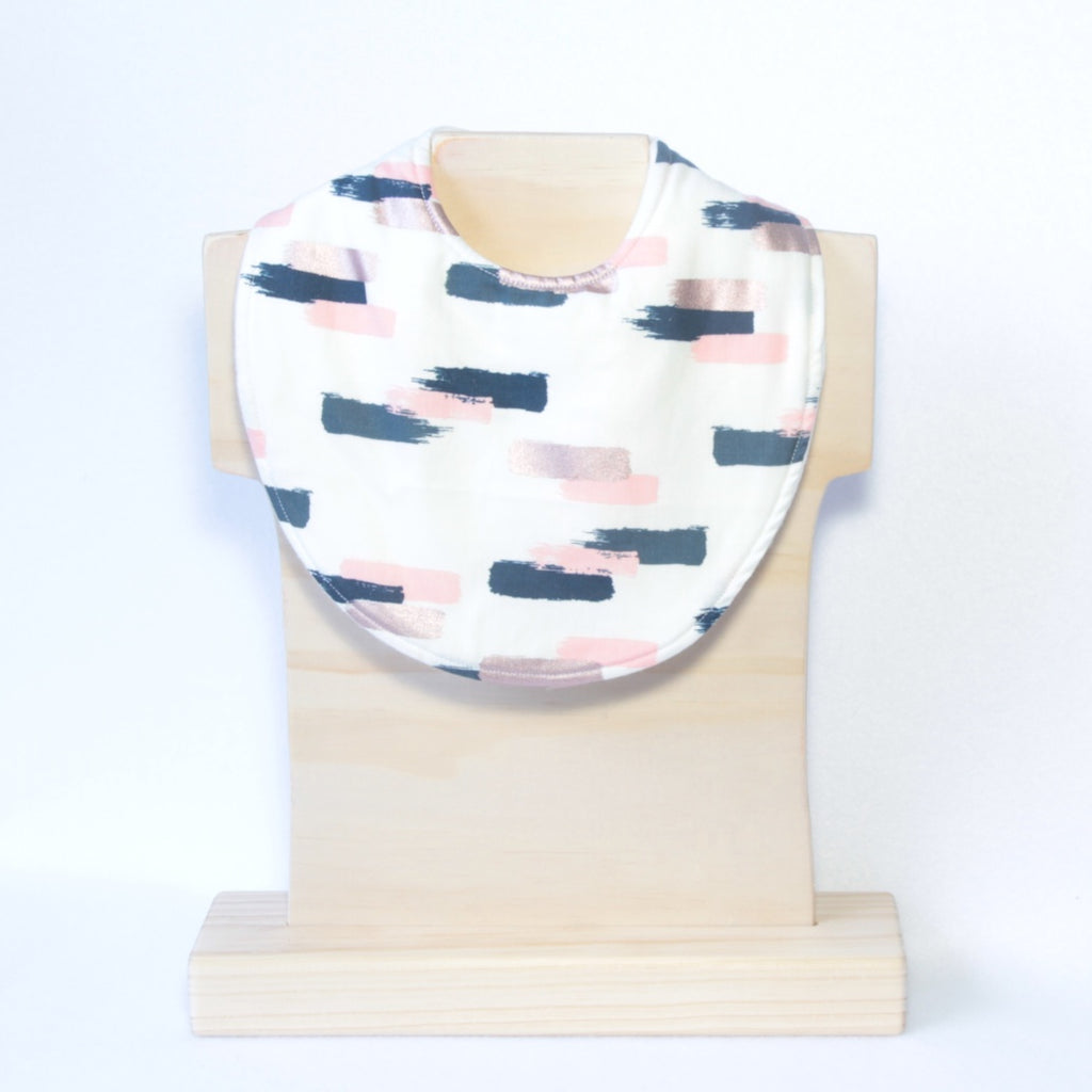 Mucky Duck Crafts Cream with Navy Pink and Roase Gold Dashes Regular Dribble Bib