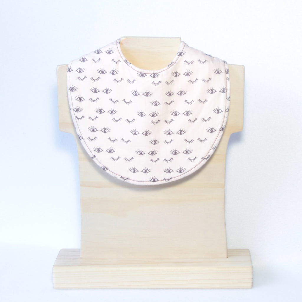 Mucky Duck blush pink eye dribble bib