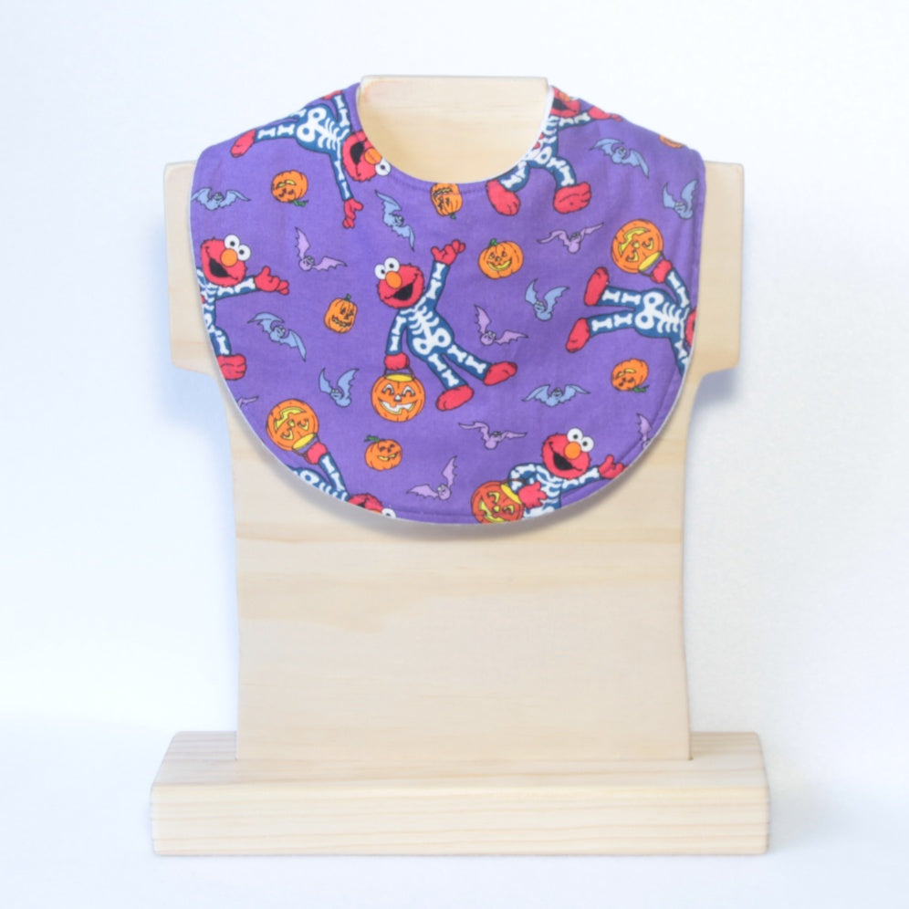 Mucky Duck Crafts purple with elmo skeletons and orange pumpkins halloween regular dribble bib