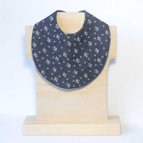 Mucky Duck navy white flowers floral dribble bib