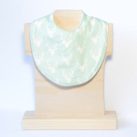 Mucky Duck mint and white stabs dribble bib