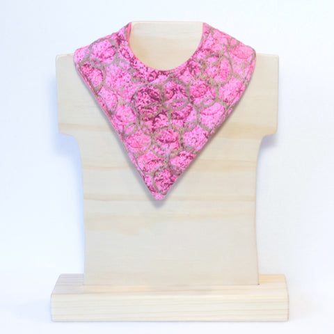 Mucky Duck pink with gold overlapping circles bandana dribble bib