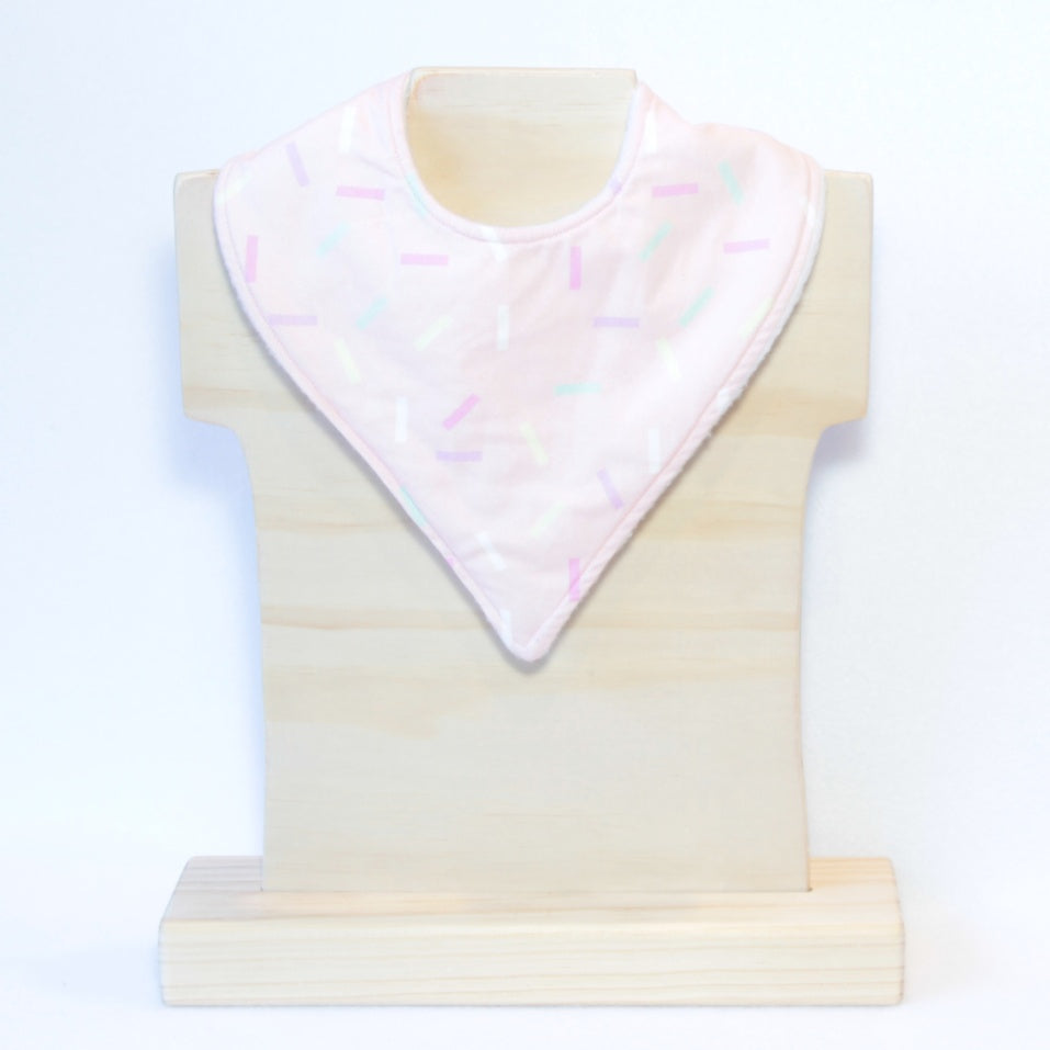 Mucky Duck pastel pink with pastel multi coloured sprinkles bandana dribble bib