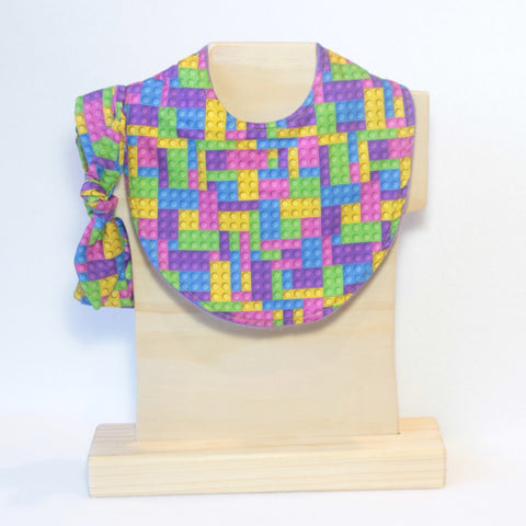 Mucky Duck Crafts bright pink purple blue and yellow building blocks regular dribble bib and matching top knot headband