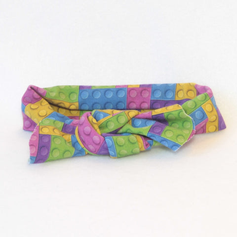 Mucky Duck Crafts bright purple pink blue green and yellow building blocks stretchy top knot head band