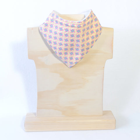 Mucky Duck yellow with blue and pink pinwheeels bandana dribble bib