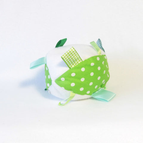 Mucky Duck green and white polka dot sensory ball