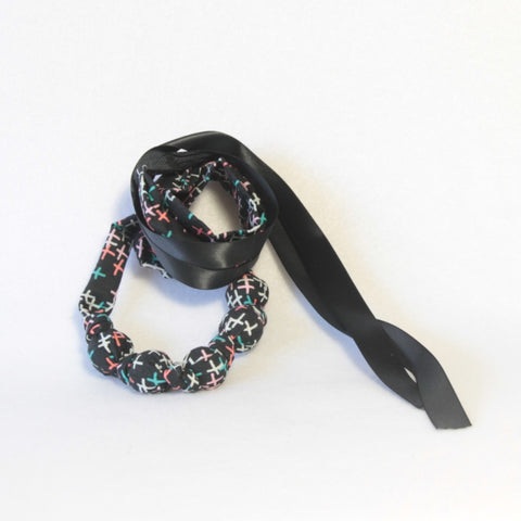Mucky Duck black with multi coloured crosses fabric necklace
