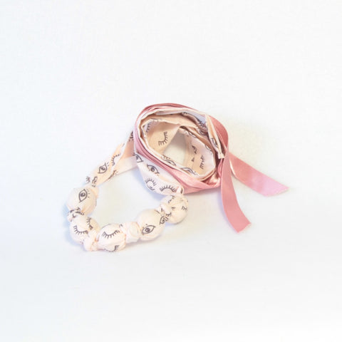 Mucky Duck blush pink eye fabric necklace
