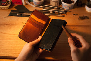 Making a leather wallet.