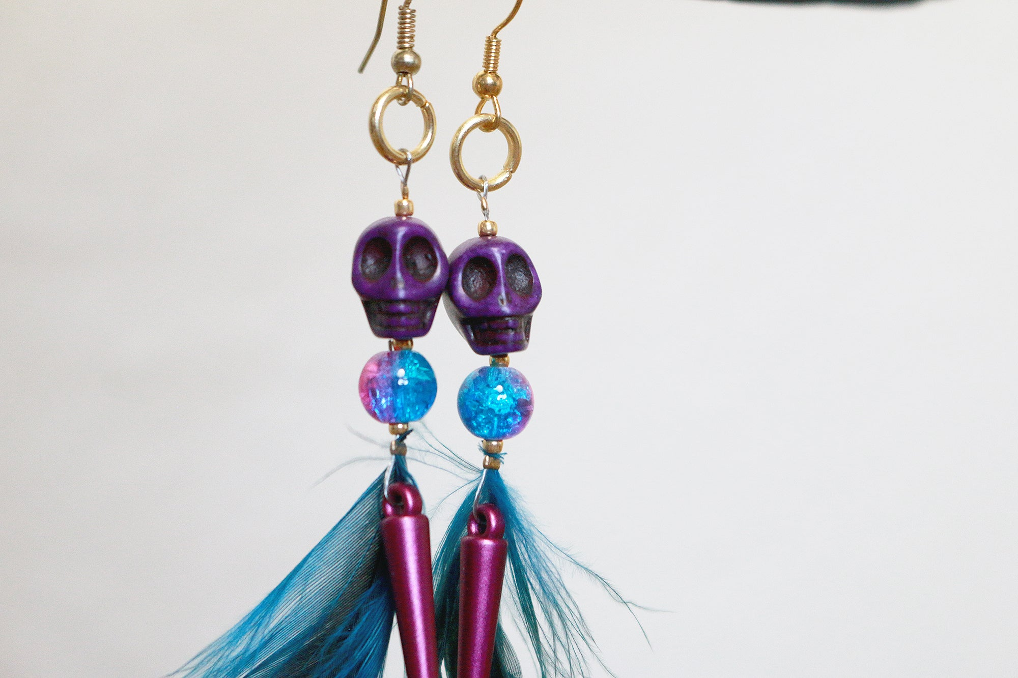Spike howlite skull feathered earrings