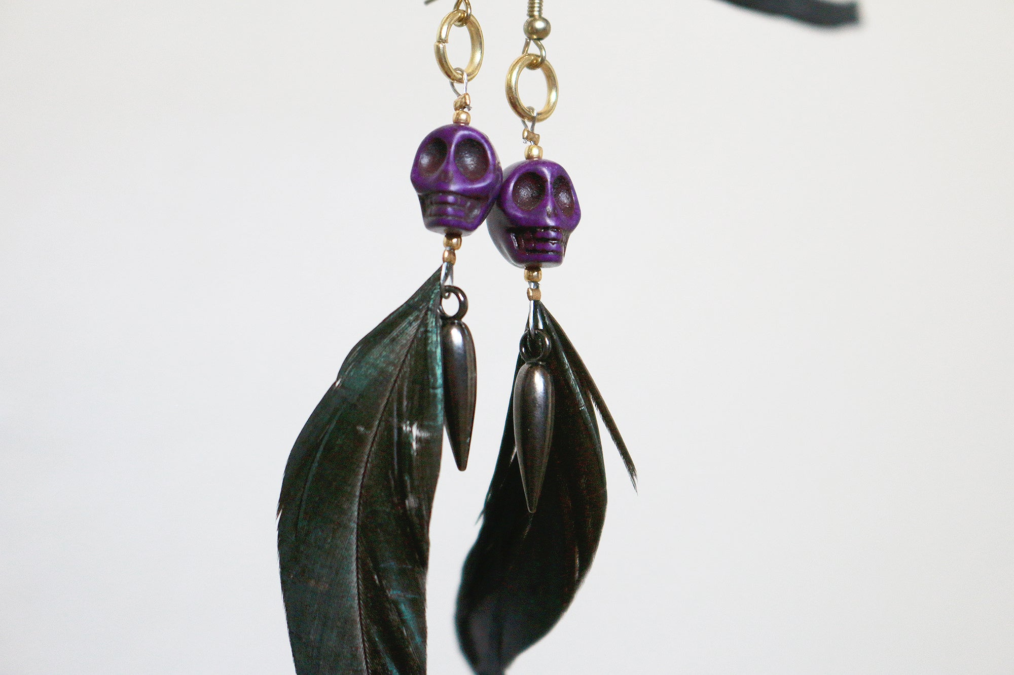 Howlite skull feathered earrings