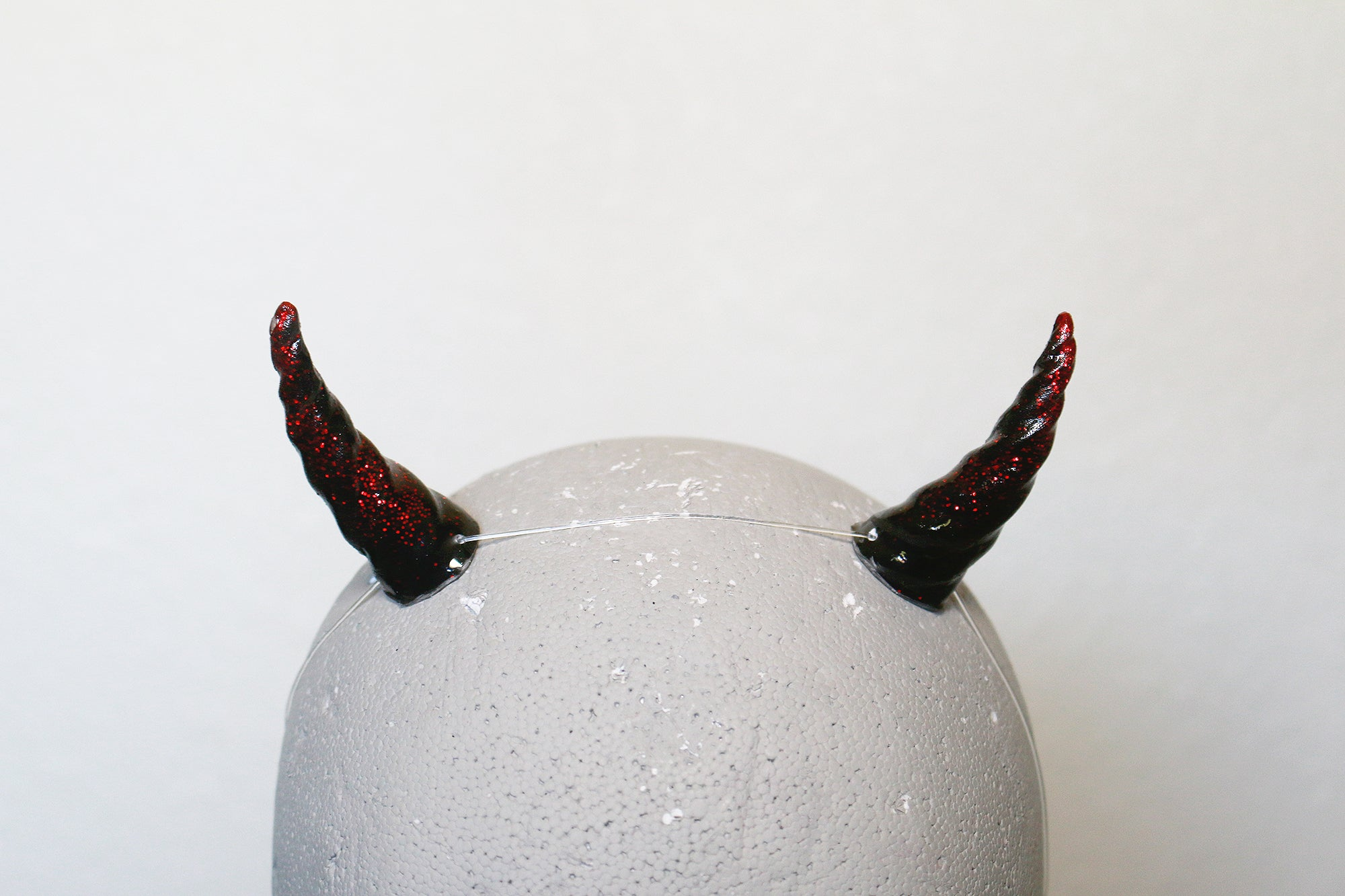 Red glitter and black sprite horns