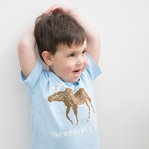 Child wearing Pale Blue Organic T Shirt with Incredible Elk Design