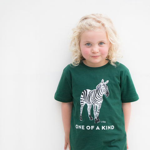 Child Wearing Zebra Organic T Shirt in Bottle Green