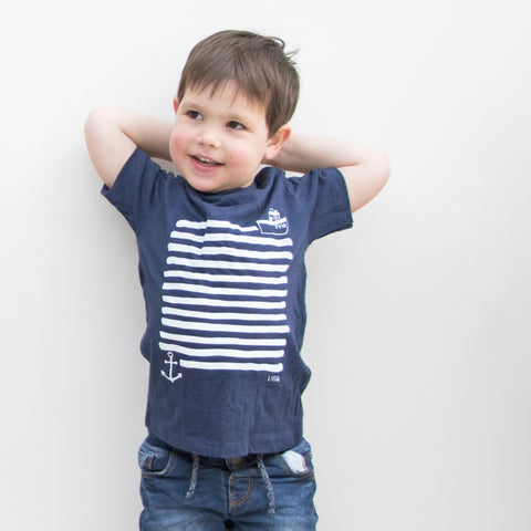 Child wearing Navy Organic Cotton T Shirt with White Boat and Anchor Print