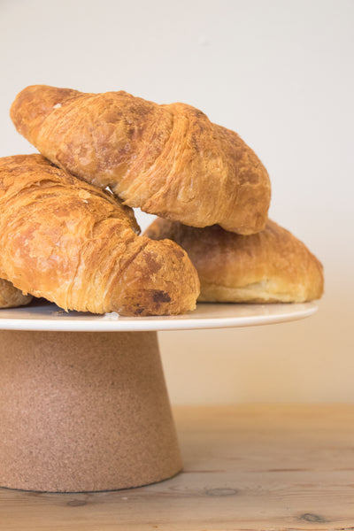 Croissants served on Cream Ceramic and Cork Serving Plate