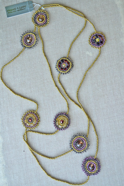 Beaded necklace with rounded accents