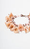 SOLD -- 1930s Peach Celluloid Lilies Bracelet
