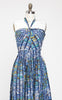 SOLD -- Amazing 1950s Tiki Print Hawaiian Halter Dress with Matching Wrap