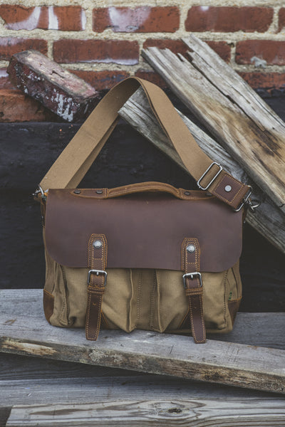 Khaki canvas messenger bag with brown leather flap and straps