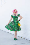 Adorable 1950s Style Green Tiki Bandana Print Dress
