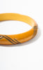 SOLD -- 1930s Carved Butterscotch Bakelite Bangle with Green Resin Design