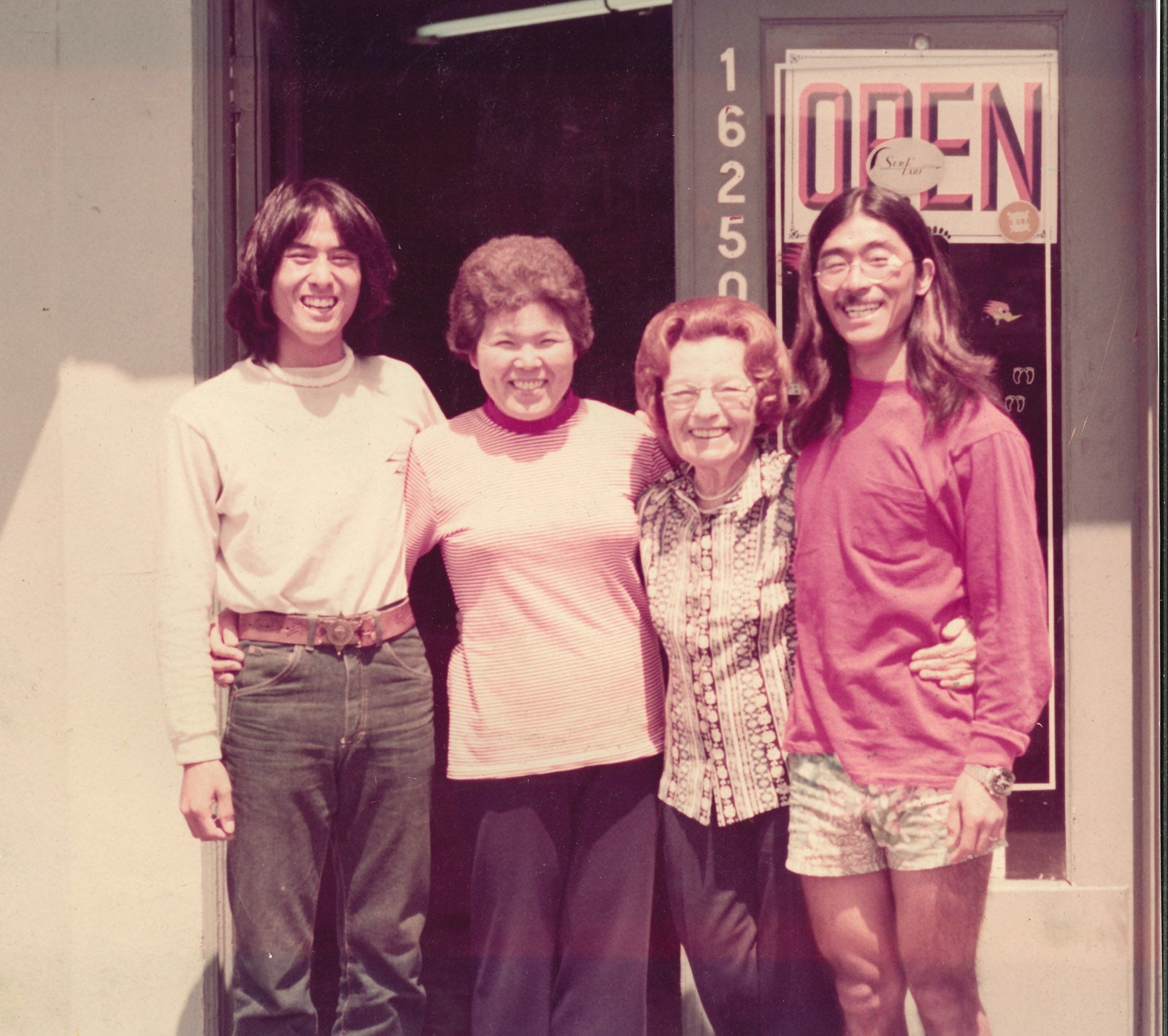 Sato & Nancy with friends in front of the Katin store.