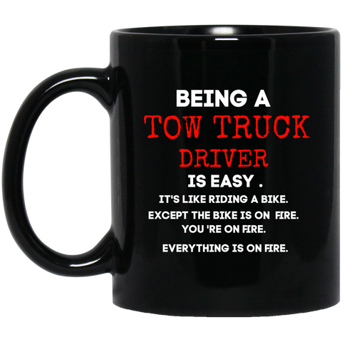 Being A Tow Truck Driver is easy .  11 oz. Black Mug