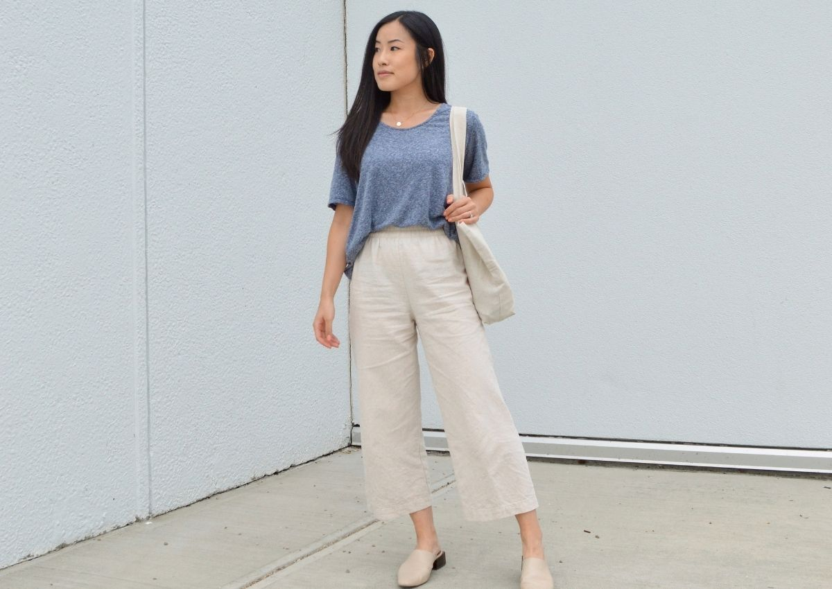 Navy blue t-shirt styled with cropped white wide leg pants