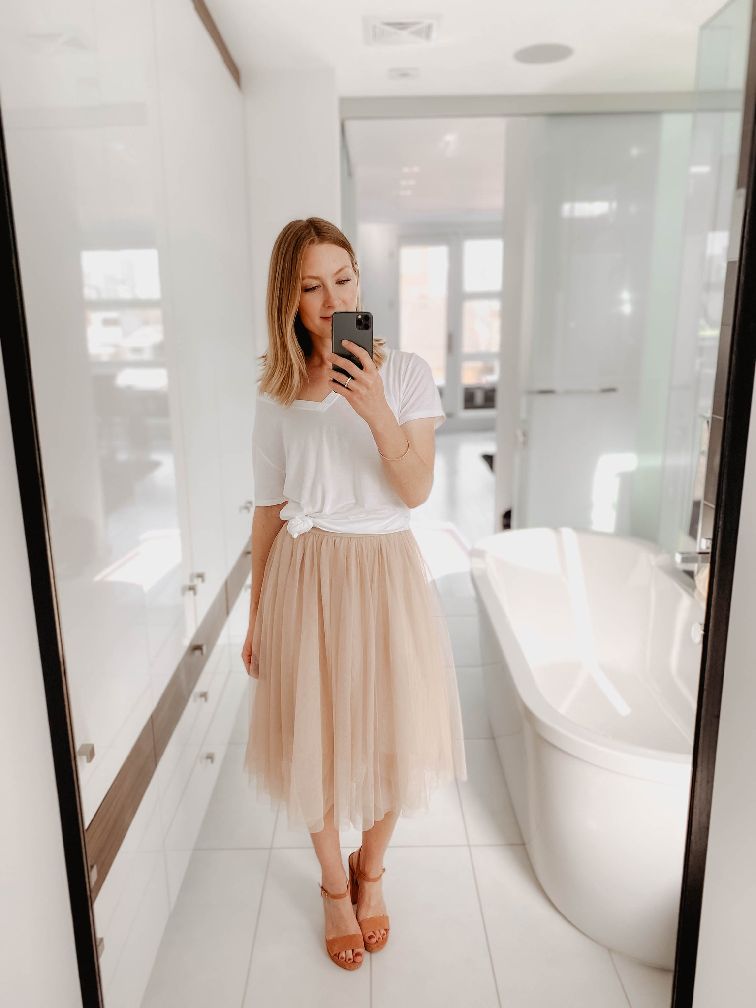 White t-shirt with light pink skirt