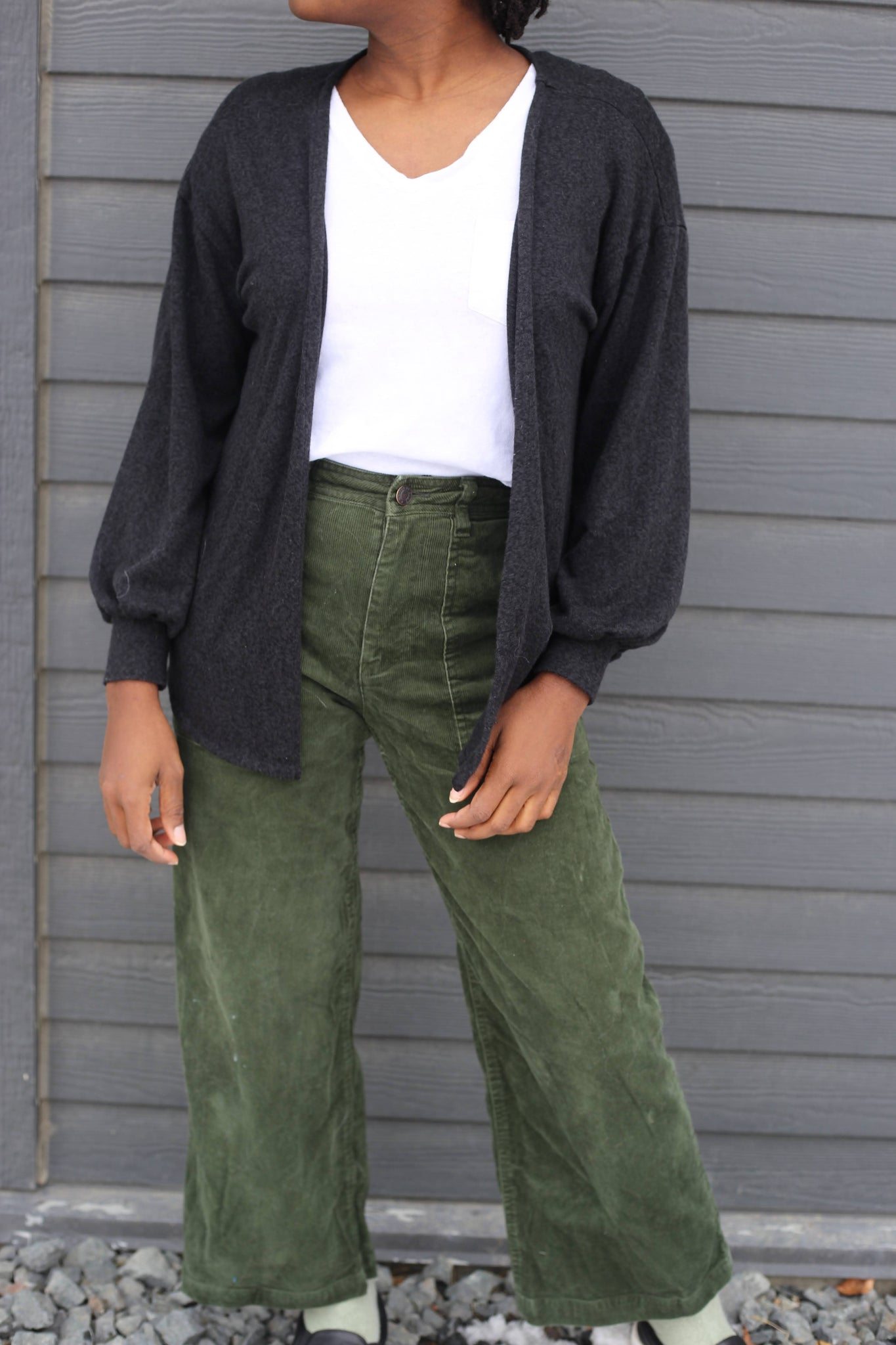 White T-Shirt and olive corduroy pants